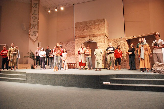 "The cast—all members of the Jubilee congregation—rehearses a number from ""Christ Alone."""