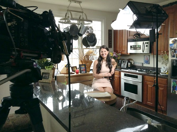BethAnn Telford being filmed in her Fair Lakes kitchen for the Discovery Channel.
