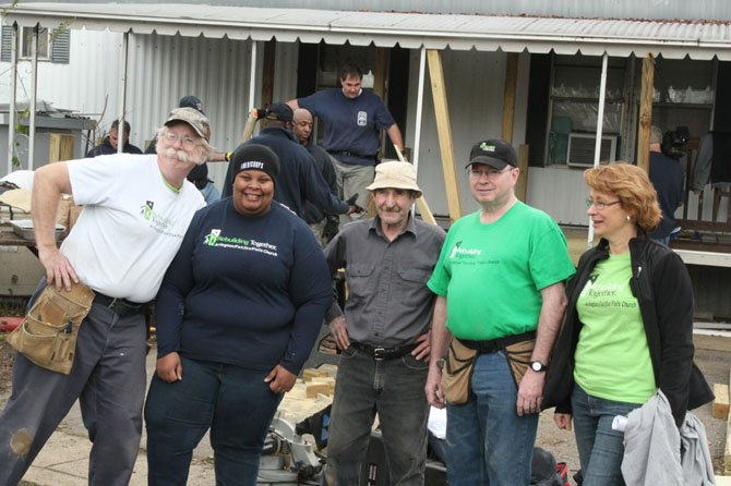 Volunteers for Rebuilding Together, the organization that coordinated the wheelchair ramp project,  work to improve safety and enable people to stay in their homes.