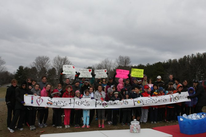 People came from Reston, Great Falls, Fairfax, Alexandria and Bethesda Sunday, March 3, to Lake Fairfax Park to run and walk 26 laps for each of the lost lives at Sandy Hook. First row, from left: Nina Paul, Sofi Blanco, Millie Blanco, Natalie Hutchinson, Bridget Crotty, Carly Hill, Faith Ann Finch, Erika Chung, Sydney Monserrate, Caden Southworth, Grady Gentile, Grant Kim, Grayson Miller, Emerson Miller, Ry Lindley, Cooper Girolamo, Nate Lindley, Harper Scruggs, Dawn Price.