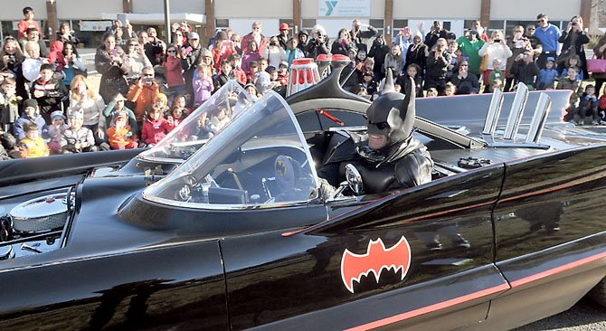 Batman (Lenny B. Robinson) arrives to a cheering crowd at the North 13th Street YMCA on Friday afternoon.