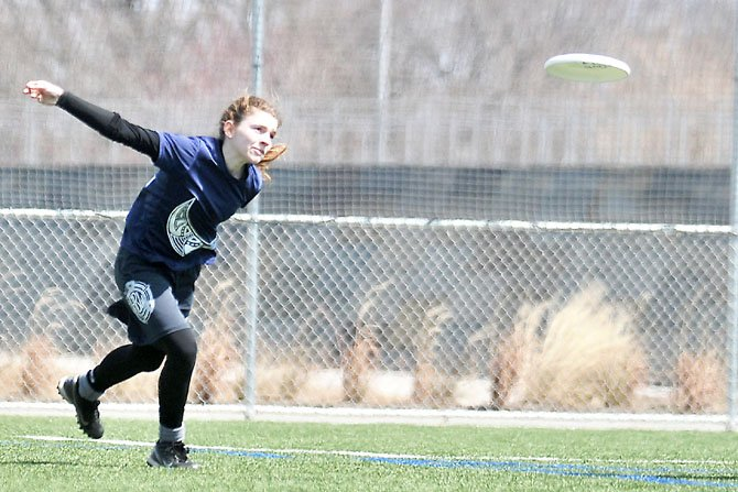 Allison Hahn sends the Frisbee down the field for the return throw after her team scored.