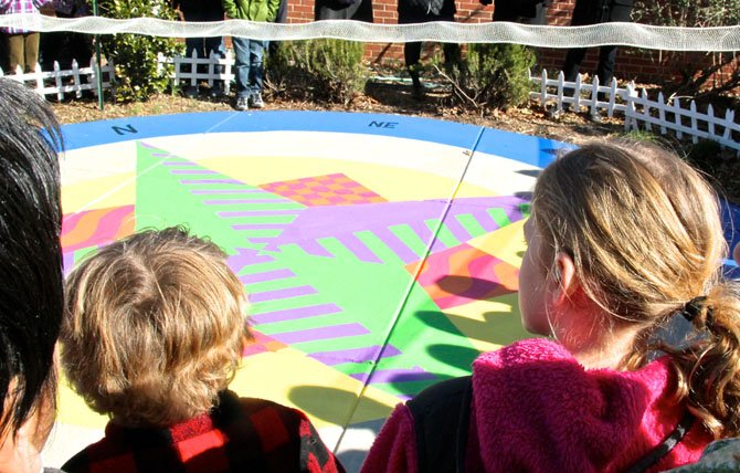 The 2nd grade students made their own Compass Rose pictures. The artwork was spread out on the floor and some of the designs were incorporated into the large one painted in the garden.