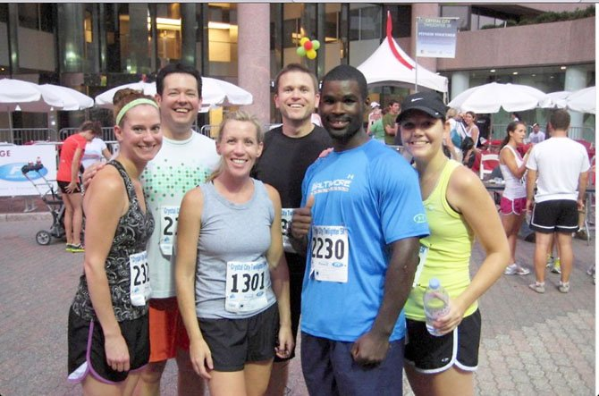 Terrill Jefferies, physical trainer and group running coach, enjoys a post race moment with friends in Crystal City. According to Jefferies, the most important part of racing is to have a training plan. Jefferies holds training runs every Saturday at Roosevelt Island starting at 12 p.m. For more information contact Jefferies at: tirelesstrainer@gmail.com.