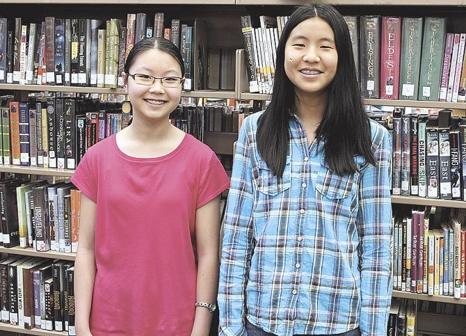 From left are Paulina Song and Christine Zhao, Rocky Run Middle School's two winners in the Scholastic Writing Competition.
