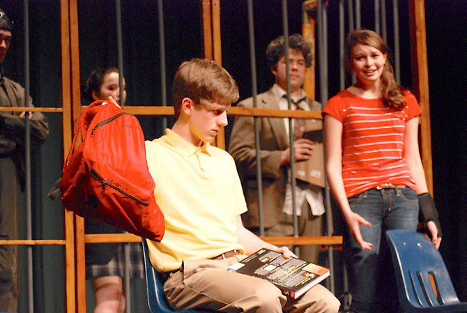 "Austin, an autistic teenager (William Shipley), struggles to connect with his classmate Lily (Bonnie McClellan) while Ben Koses, one of the personified voices in Austin's head, looks on in ""The Other Room,"" by Ariadne Blayde at West Springfield High School."