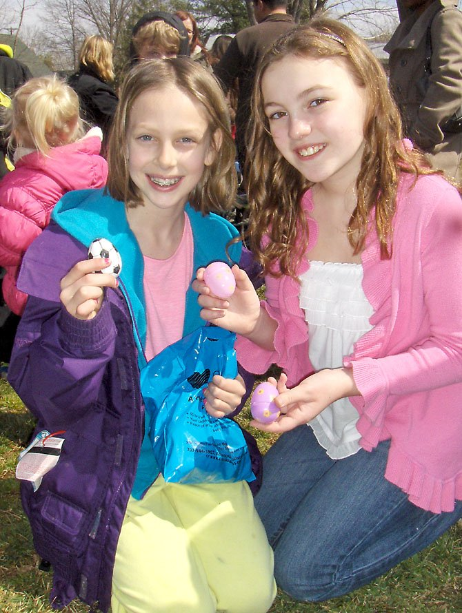 Carolyn Rohr, left, and Kaitlyn Ellis, both 10, show the eggs they found.