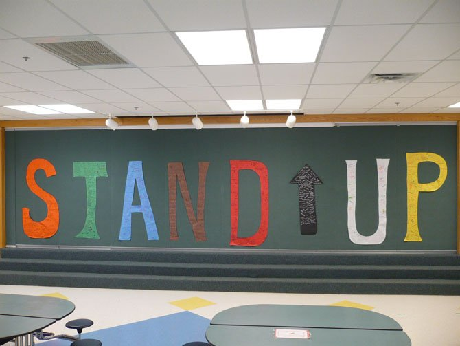 "Colin Powell Elementary School's slogan for the week was ""Stand Up"" — each grade level had a letter that all of the students signed."
