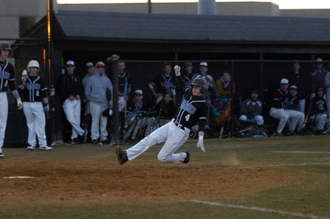Centreville's Drew Brickwedde slides into home plate against West Potomac on Tuesday.