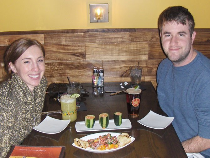 Jenelle Whittaker (left) and Ryan Owens enjoy Southwestern Caprese Tapas and Gazpacho Shots.