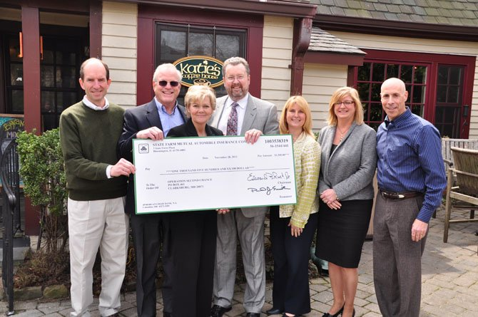 From left, Old Brogue owner Mike Kearney, local realtor Bob Nelson, Operation Second Chance Founder Cindy McGrew, Stephen Dulaney, Tami Harsanyi and Pam Hennessey of State Farm and and Rob Jolles of Jolles Associates at Katie's Coffee Shop Thursday, April 4. State Farm presented a check for $1,500 to Operation Second Chance, which provides care and assistance to combat veterans.