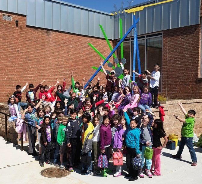 Last week, more than 300 Oakton Elementary students worked with artist Kevin Reese, a sculptor-in-residence, to design and build this high-flying, swirling mobile unveiled during a dedication ceremony at the school on Friday, April 5.
