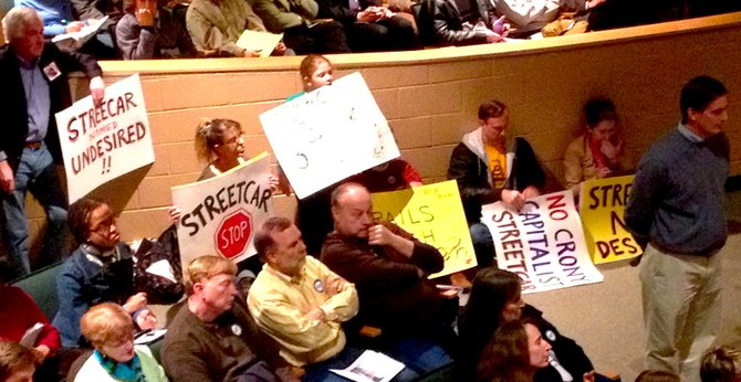 Opposition to the streetcar line waits to speak against the project.
