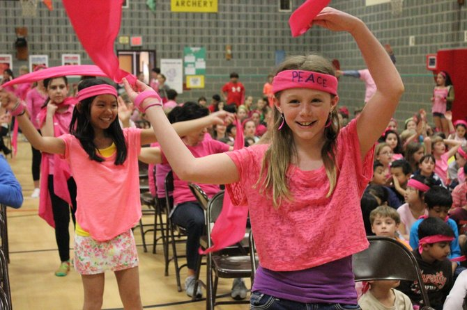 SCA Representative Caroline Keys (front) waves her pink bandana, building enthusiasm among the students for the anti-bullying pep rally.
