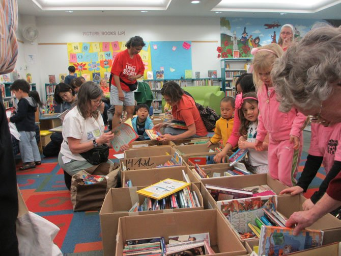 "Childrens' books were placed on floor level for children to sort through. One little girl called the books ""amazing."""