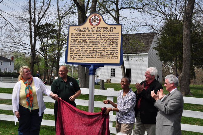 From left, Kala Quintana and Bill Bouie of the Fairfax County Park Authority Board, Supervisor Cathy Hudgins (D-Hunter Mill), Jack Pitzer, president of the Friends of Frying Pan Farm Park and Del. Tom Rust (R-86), unveil a new historical marker at the Frying Pan Meeting House Sunday, April 14.