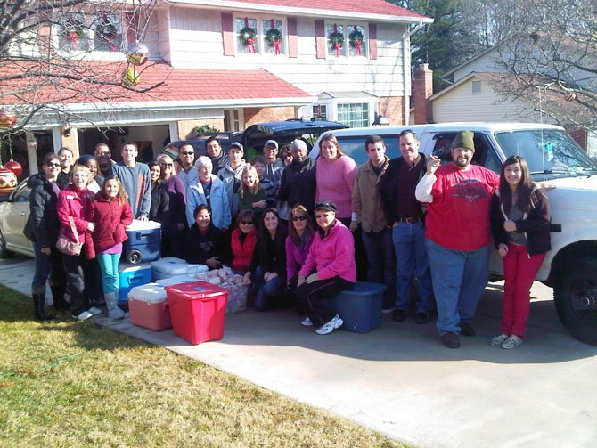 The 25th Project Team gathers on Christmas morning 2012, ready to deliver meals and presents to the homeless. Many members are from Burke Community Church.