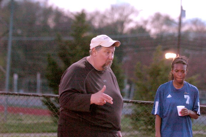 Robinson girls' soccer coach Jim Rike talks to the Rams during halftime of a 6-0 win against Mount Vernon on Friday, April 12. Rike reached 500 career victories earlier this season.