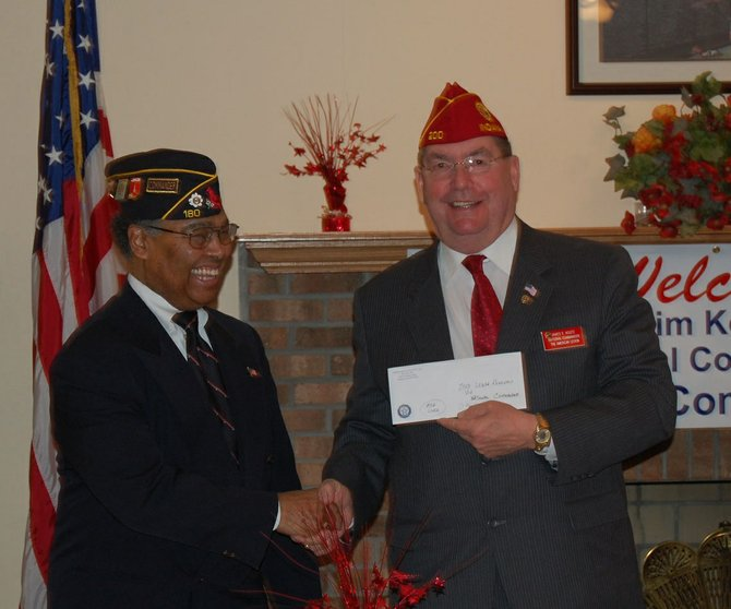 Commander Ron Patterson, of Post 180 Vienna, presents a check for Operation Comfort Warriors to American Legion National Commander Jim Koutz.