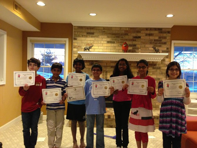 Students who received honors in the state competition are, from left, Arsh Siddiqui, Vishnudev Jeyaraj, Viraj Chegu, Ayush Viswanathan, Likhitha Addagatla, Rithika Murugesan and Ella Chandan.