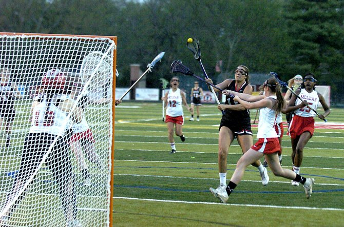 Madison senior midfielder Melissa Kellan shoots during a game against McLean on April 18.