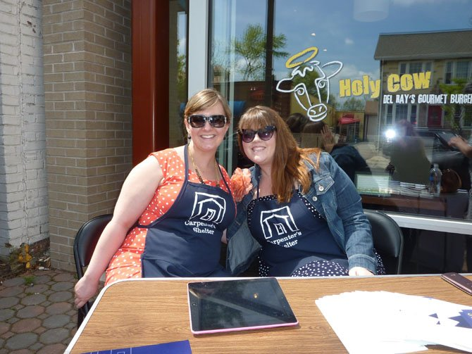 Kelly Andreae and Courtney Bishop raise funds for Carpenter's Shelter in front of Holy Cow restaurant in Del Ray. The organization raised $14,355 in 24 hours.
