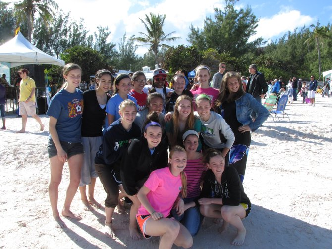 FCV 98 at the Bermuda Annual National Kite Festival. Left to right, back row: Gabriella Gordon of Fairfax, Allison Maliska of Loudoun, Quinn Rogers of Centreville, Katie Le of Centreville (local TV announcer), Casey Peterson of Clifton, Isabella Gordon of Fairfax, Randi Palacios of Vienna; third row: Kathleen Brumagim of Haymarket, Rebecca Crouch of Annandale, Kelsey Hamer of Centreville, Kaitlyn Small of South Riding; second row: Grace Mondloch of Clifton, Rachel Fischer of Clifton; first row: Abigal Rynex of Chantilly, Catherine Kwitnieski of Loudoun.