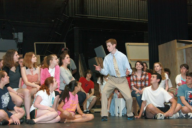"South County sophomore Jack Gereski as Harold Hill rehearses with the cast of ""The Music Man."""