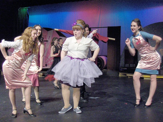 "(From left) Rachel Ingle, Mady Hanton, Hannah Sikora and Katie Mahon-Kuzin rehearse a number from Robinson's ""Hairspray."""