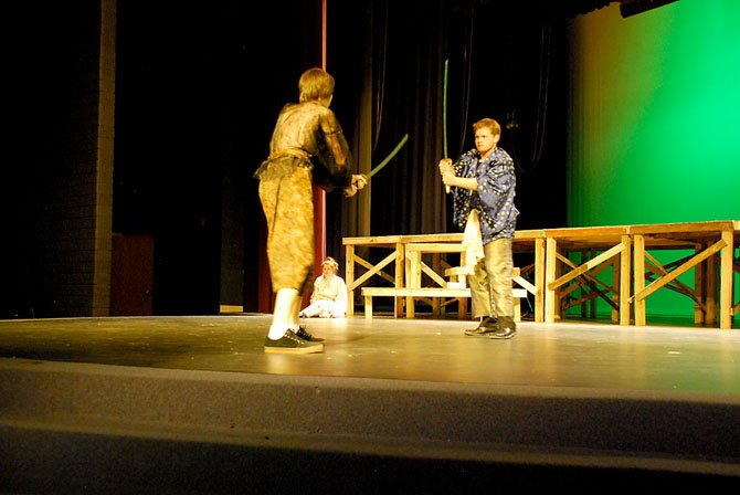 Sophomore Liam Finn (left) and senior Zach Newby (right) battle with samurai blades for the samurai's wife, played by senior Sarah Beck (center).