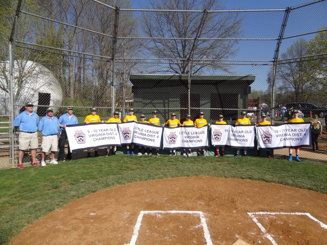 The 2012 Great Falls All Star team holding the banners of the championships that they won while they were Little Leaguers. This photo was taken as part of the Great Falls Little League Opening Ceremonies that were held last weekend as they were honored for their accomplishments.