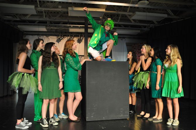 The Ozians surround Aydin Johnson, who plays The Wiz, the title character in Cooper Middle School's upcoming production.