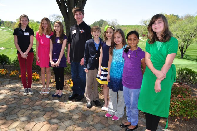From left, Great Falls Elementary School students Caroline Stock, Laura Gersony, Sonia Toloczko, Alex Marjanovich, Will Kiser, Ana Grajdeanu, Elena Berrios, Muntaha Haq and Maddie Cross, winners in the annual Great Falls Friends and Neighbors poetry contest. Great Falls fifth grader Mary Kurbanov was also a winner, but was unable to attend the Friday, April 26, awards luncheon.