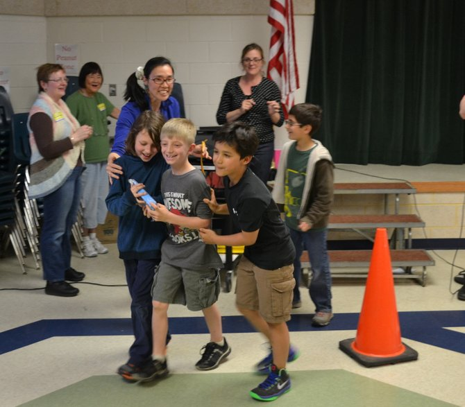 "Third graders Zander Kuebler, Will Tedesco, Antonio Hernandez, and Nedim Ozden won the school's Best Performance award for their ""Rap Cycle"" performance."