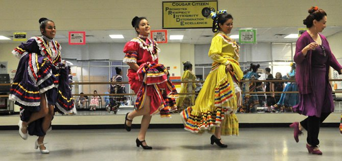 Artistic director Laura Ortiz leads the dancers of Los Quetzales Mexican Dance Ensemble in a traditional dance.