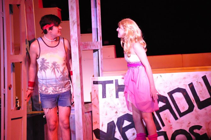 "Sonny, played by Ben Peter, and Kira, played by Natalie Pernick, discuss starting a roller disco during South Lakes High School's production of ""Xanadu."""