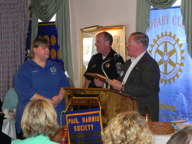 Tammy Barker; Chief Jim Morris, Vienna Police Department; Rotarian George Creed.