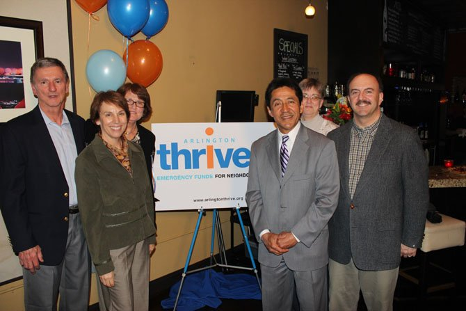 County Board members Walter Tejada, Libby Garvey, Mary Hynes and Chris Zimmerman stand with Arlington Thrive Board President Bob Zawacki and Executive Director Geraldine Shannon