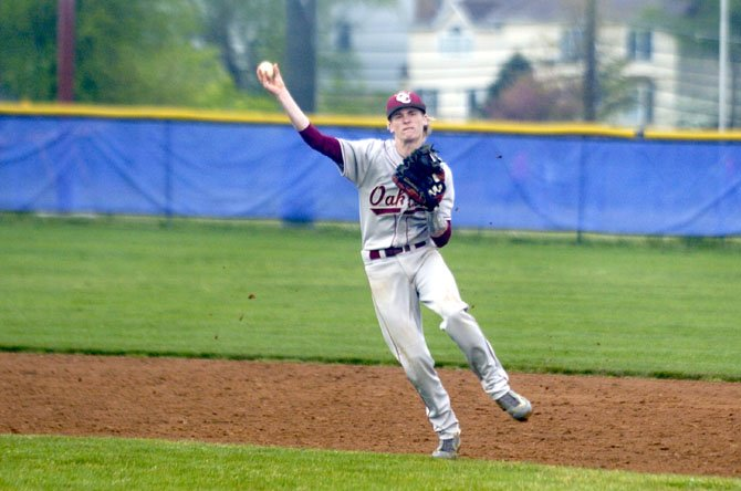 Oakton shortstop Mitchell Carroll throws during Tuesday's contest at Chantilly.