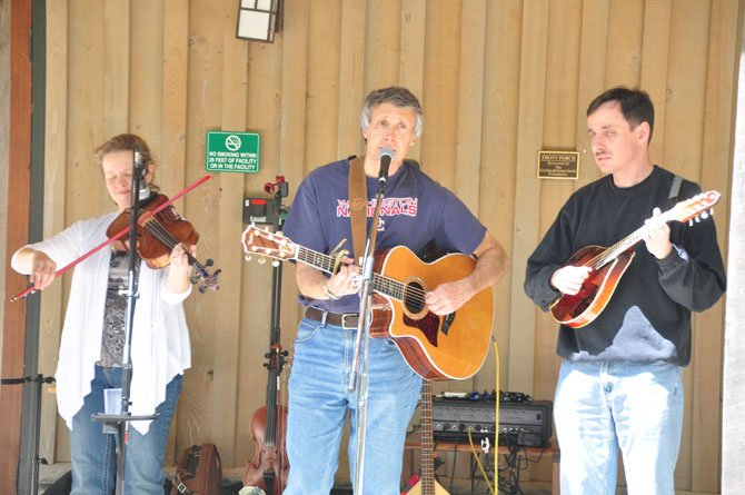 From left, Marcy Cochran, Tom Bodine and Steve Malyszka perform at the Walker Nature Education Center Saturday, May 4, as part of the Reston Spring Festival.