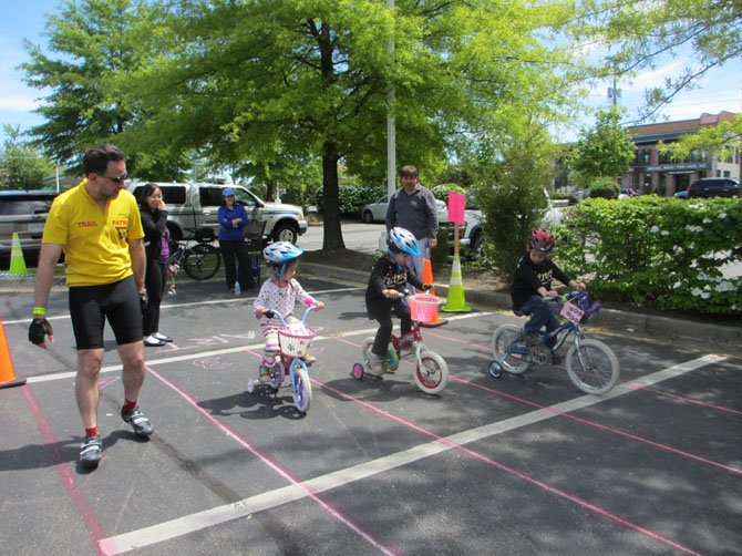 Ladies and gentlemen, start your pedals… a member of the W&OD bike patrol paces youngsters negotiating lanes.