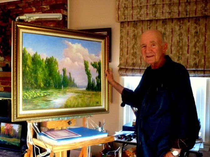 Emergent artist Donald Rogich poses with a landscape work of the scenic George Washington parkway near Alexandria. Price points for work by local artists can range from $100 to $500, and are a heartfelt present for mom.