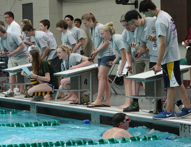 Potomac Marlins swimmers from throughout Fairfax County volunteered at the recent Special Olympics Swim Meet, hosted by The Potomac Marlins and held at George Mason University.