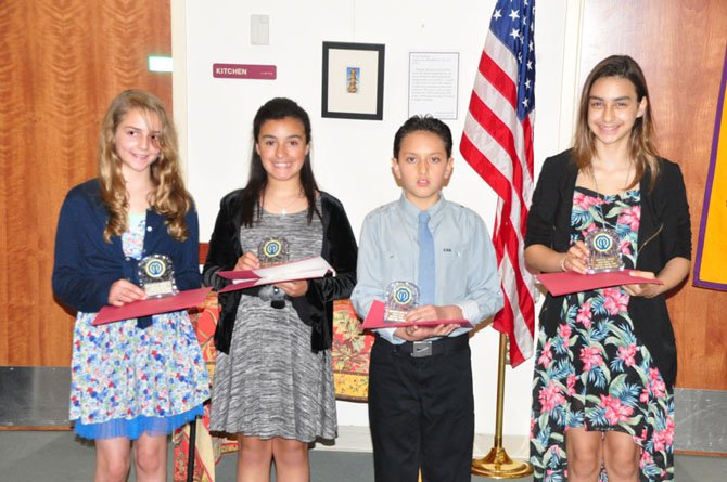 From left, Great Falls sixth graders Katarina Christie, Sabrina  Vazquez, Alejandro Garcia Donoso and Daniela Arbid are honored by the Great Falls Optimist Club Wednesday, May 8.