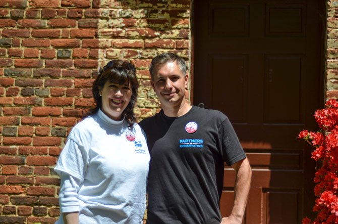 Colvin Run Mill volunteer Karen Hogan and Fairfax County Park employee Matthew Kaiser at the Millers House.