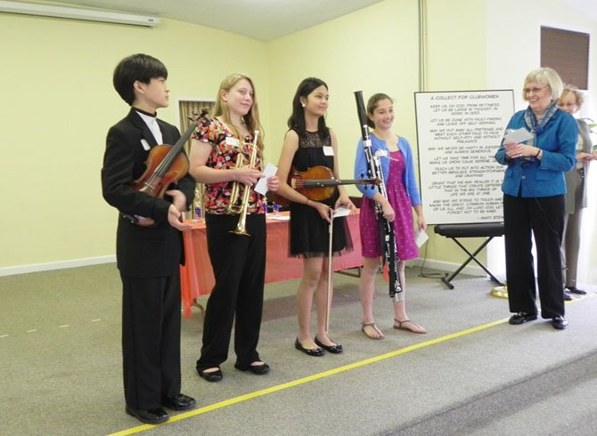 From left: Student musicians Minyoung Hwang, of Longfellow Middle School; Nancy Kurtic, of Cooper Middle School; Katherine Quion, of Cooper Middle School; Jennifer Steele, of Longfellow Middle School; Virginia Sandahl, president of the Woman's Club of McLean, and Marianne Polito, club president emeritus.