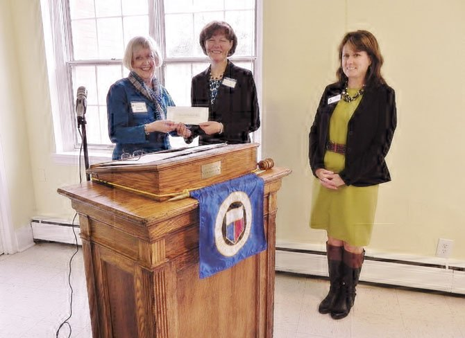 From left: Virginia Sandahl, president of the Woman's Club of McLean; Rear Admiral (Ret.) Kathleen L. Martin, executive director of the Navy Marine Coast Guard Residence Foundation, which supports the Wounded Warrior program; and Paula Manczuk, the foundation's director of development.