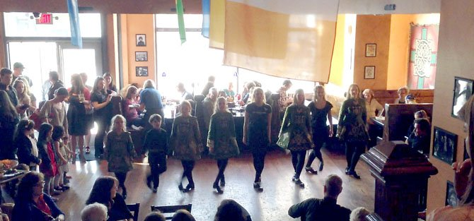 Irish dancers from Arlington to Baltimore united to raise more than $10,000 for one of their own in Dorchester, Mass., who was seriously injured in the Boston Marathon bombing.