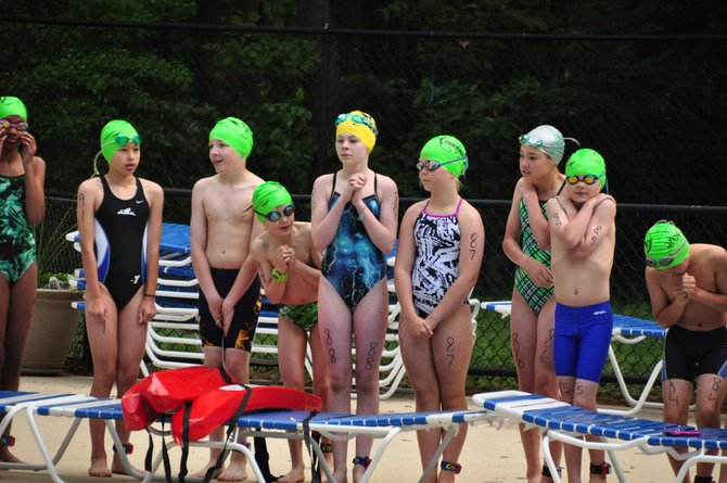 Swimmers at the Reston Youth Triathlon prepare to enter the water at the Ridge Heights Pool Sunday, May 12.
