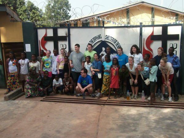 Students from a previous service trip pose for the cameras with some of their new friends at the Child Rescue Centre in Bo, Sierra Leone. Floris United Methodist Church, with Senior Pastor Tom Berlin at the helm, will lead a local group of young adults on the next service mission from May 26 through June 9.